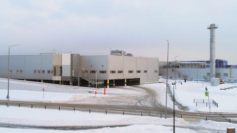 aerial motion to manufacturing complex on snowy cold day Live Action