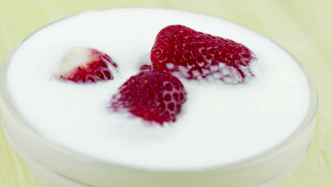 healthy strawberries in the transparent cup with white yogurt, concept of healthy fruit food Live Action