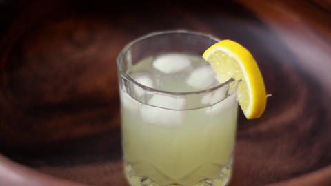 Lemon fruit Caipirinha alcoholic beverage or homemade fresh lemonade in glass Live Action