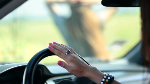 Woman's hand sliding on car's steering wheel Footage