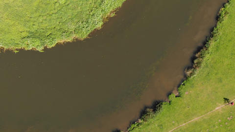 JSP-0754 Canal river view from drone with cyclists on toe path Footage