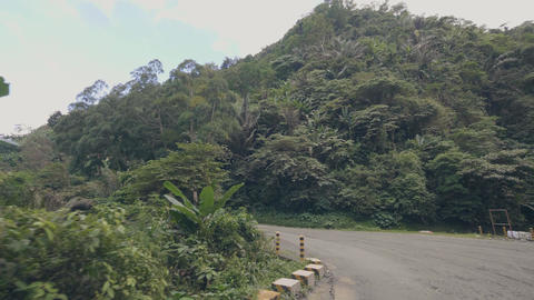 Point of view from driving car or motorcycle on mountain road and green hills Live Action