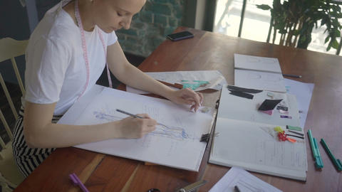 Young fashion woman designer drawing design sketch... Stock Video Footage
