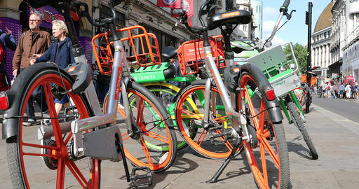 Many Electric Bicycle Rental On The Sidewalk Live Action