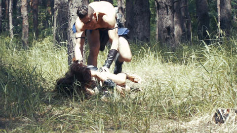 Forest chase, barbarian man is chasing a woman in the forest, she fights back Live Action