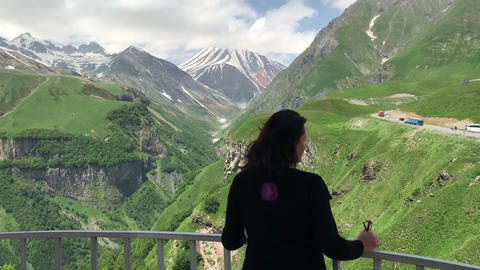 Woman Standing on View Point and Admire Mountains Landscape Footage