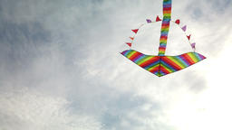 Rainbow kite flying in blue sky Footage