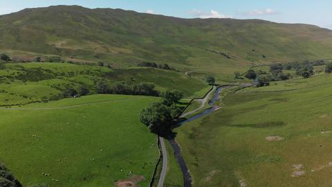 A descending aerial shot of Barbon Beck Carnforth Lancashire (V346) Live Action