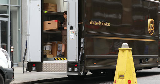 UPS Delivery Woman Preparing To Deliver Packages Live Action