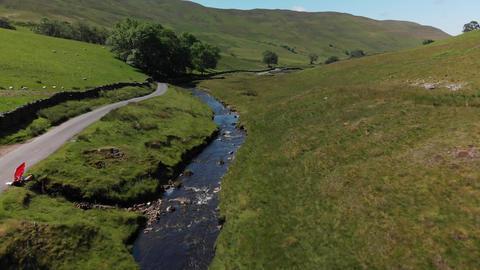 A slow aerial shot of Barbon Beck Carnforth Lancashire (V361) Live Action