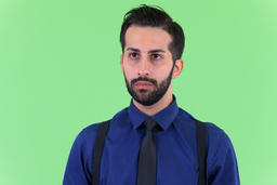 Face of young handsome bearded Persian businessman thinking Photo