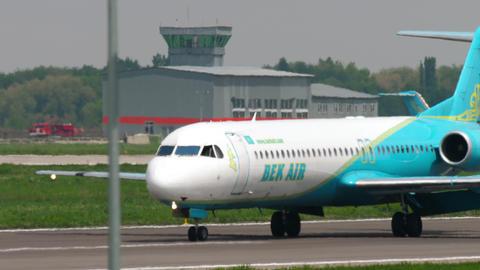 Bek Air Fokker F100 taxiing after landing Footage