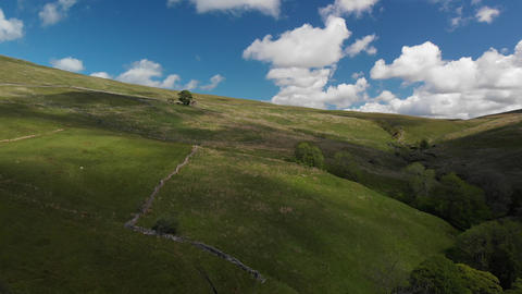An aerial shot of the green hills in Cumbria (V401) Live Action