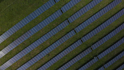 Descending over solar panels (V449) Live Action