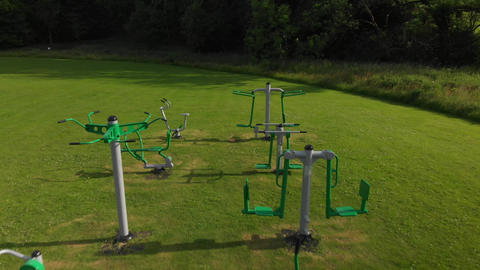 Pullback of outdoor exercise equipment in a field (V457) Live Action