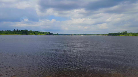View of Lake Scenery With Jet Skis on the Water Jet skiing. Lakeside Shore and Water With Personal Footage