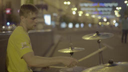 Street musician plays drums on Khreshchatyk street at night. Kiev. Ukraine. Kyiv Footage