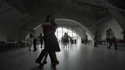 Wide dancing hall with a window where people are dancing tango (milonga) Footage