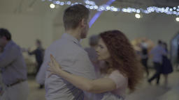 Man and woman dancing tango in the evening in the dance hall (milonga) Footage