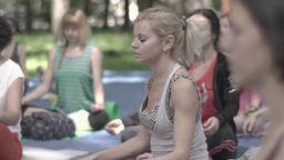 Young girl meditating in Lotus position during a yoga class . Slow motion Footage