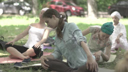 Girl does yoga in Park, sitting in the Lotus position . Slow motion Footage
