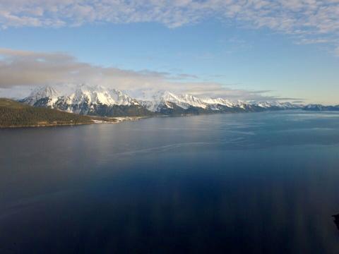 Sun hitting the beautiful fiords of Seward Alaska Photo