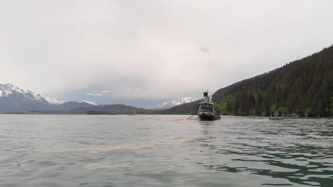Sea level view of commercial fishing boat Live Action