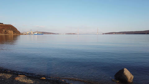 Marine landscape with views of the Russian bridge on the horizon Live Action