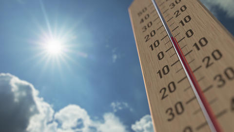 Outdoor thermometer reaches 35 thirty-five degrees centigrade. Weather forecast Live Action
