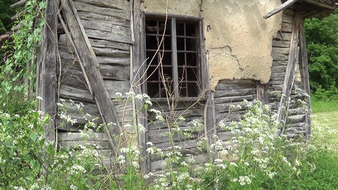 An old abandoned house a ruined wall and a window Footage