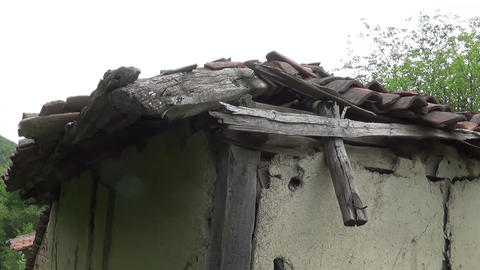 An old and broken roof on an old hut Footage