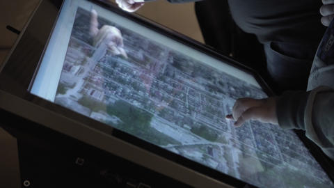 Child and man looking at map of earth on the touch screen sensory interactive ライブ動画