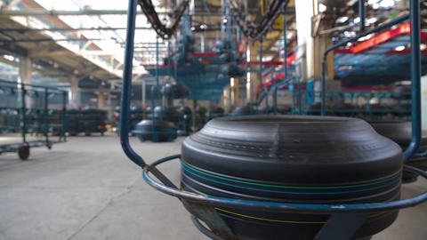 Tire moves on the conveyor at factory Live Action