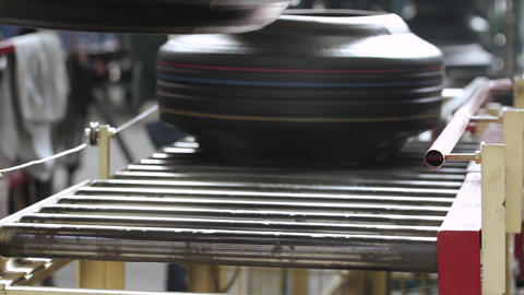 Tires on the conveyor in the tire pressing shop Live Action