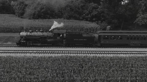 Steam Locomotive Puffing along Amish Country Farm lands in Black and White Footage