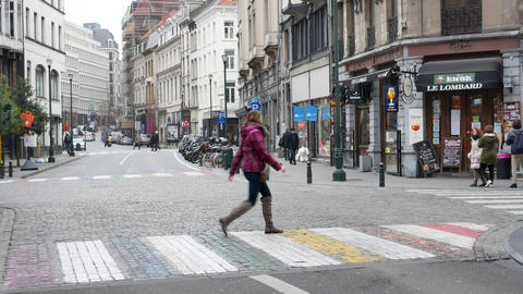 Girl crosses colorful pedestrian crossing in Brussels Live Action