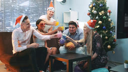 Happy New Year's celebration in cheerful company in Santa... Stock Video Footage