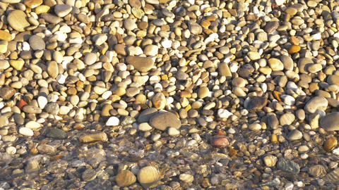 Sea view on the Nice seashore with pebble in summer day. Sea waves surface close Live Action