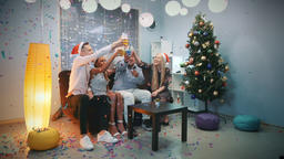 Christmas party time of happy young people in confetti blowing Footage