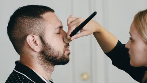 Makeup Artist Applying Makeup On Handsome Person Footage