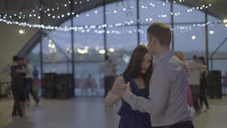 Some couples dancing tango (milonga) on the dance floor Footage