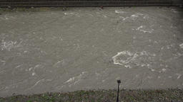 Gray opaque river water quickly flow between stony banks, muddy flow from dirty Footage