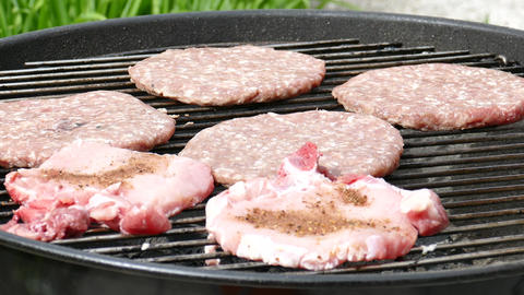 Burgers and steaks on a BBQ grill Live Action