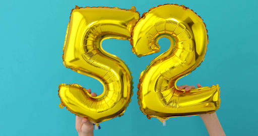 Gold foil number 52 celebration balloon Footage