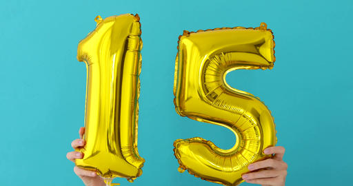 Gold foil number 15 celebration balloon Footage