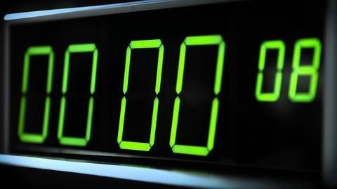 Digital clock watch. Counter with green digits Footage