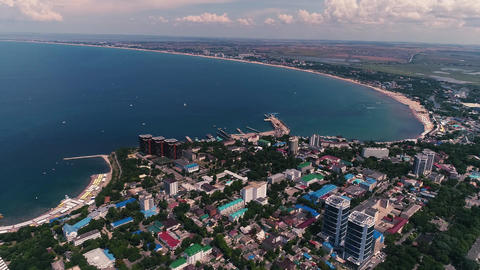 Aerial Video. The coast of a large City and wild beaches of the Black Sea. The Live Action