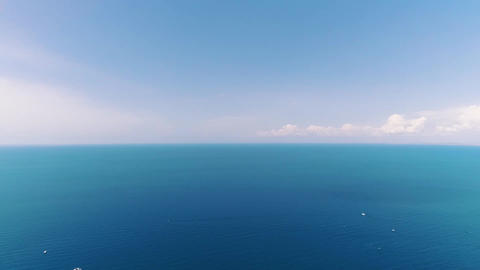 Aerial view of a luxury boat floating on the waves of the black sea Live Action