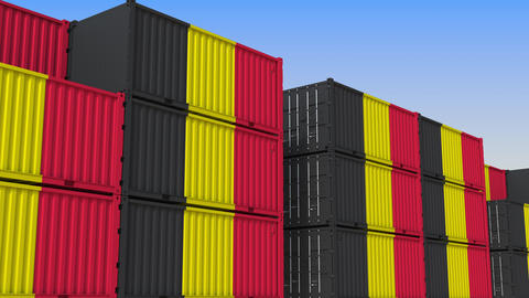 Container terminal full of containers with flag of Belgium. Belgian export or Live Action
