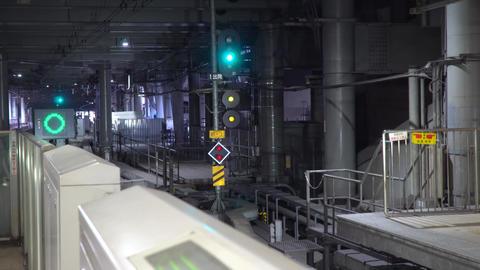 Tokyo,Japan-July 24, 2019: Commuter express train just leaving Odakyu Shinjuku station in the Live Action